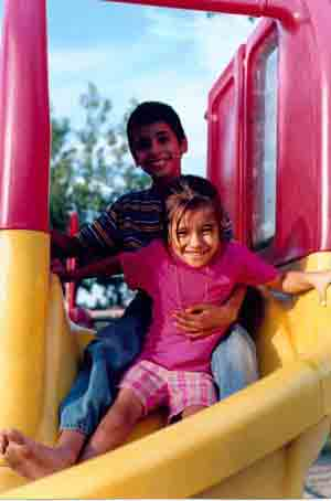 Arwinder and Lalita enjoying themselves at a playground in Magog, Quebec, Canada