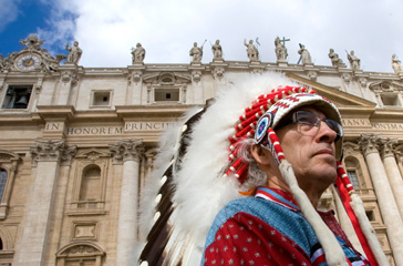 Phil Fontaine, chief of the Assembly of First Nations, wears his traditional headdress as he attends the Pope Benedict XVI general audience in Saint Peter's Square at the Vatican April 29, 2009.
